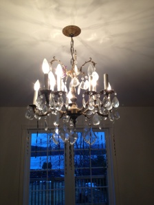 1. OUTDATED DINING ROOM CHANDELIER MAKEOVER: BEFORE. Our old brass chandelier semi-blocking the view from our kitchen to the pond - needs to 'disappear'.